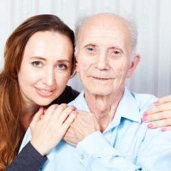 caregiver hugging old male patient